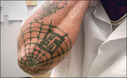 Spider web tattoos on elbow what does it mean
